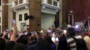 Venezuelans show support for Guaido in church after return to country [Video]