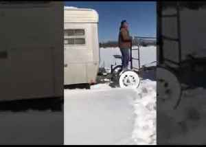 Amish Horse-Drawn Wagon Helps Remove Ice Shack From Prairie Lake [Video]
