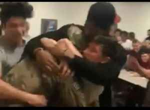High School Coach Surprises Students After Afghanistan Deployment [Video]
