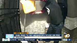 Man caught on camera trying to set neighbor's home on fire [Video]