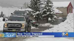 Tow Truck Driver Hit By Wall Of Snow [Video]
