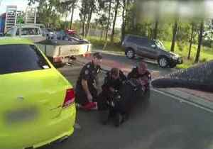 Police Forced to Dodge Reversing Car While Making Arrest [Video]
