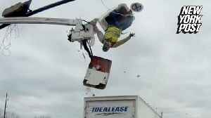 Truck smashes into a bucket, vaulting worker through the air [Video]
