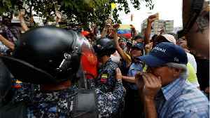 Opposition Protesters Scuffle With Authorities As Blackout Continues [Video]