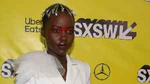 Lupita Nyong'o Futuristic Look Inspired By 80s Music [Video]