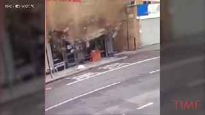 News video: Video Captures Pedestrian's Very Near Miss With Collapsing Building