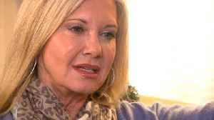 Olivia Newton-John went 'undercover' to keep cancer battle private [Video]