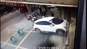 Security guard narrowly escapes death after SUV driver mistakes accelerator for brake [Video]