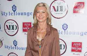 Olivia Newton-John went 'undercover' for cancer treatment [Video]