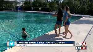 Mock drowning and rescue gives kids dramatic education in water safety [Video]