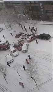 Over a dozen vehicles skid into pile-up in snowy conditions [Video]