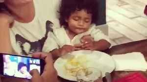 Baby can't decide between sleeping or eating, does both [Video]