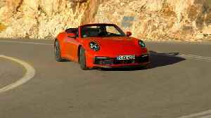 Porsche 911 Carrera S Cabriolet in Lava Orange Driving Video [Video]