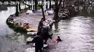 Heroic man rescues old woman and her grandson that fall into pond [Video]