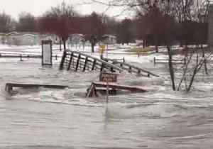 Raging Floodwaters Wash Away Bridge in Sioux Falls [Video]