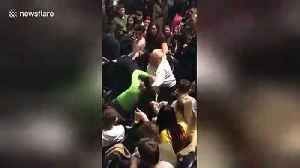 Shocking moment man karate kicks girl in face at O2 concert in London [Video]