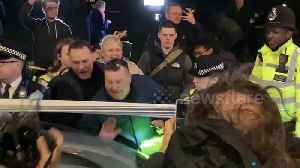 Far-right mob surrounds parked car despite police orders [Video]