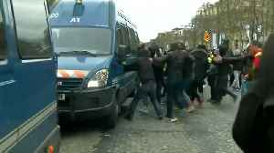 News video: French police use water cannon on
