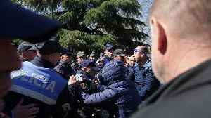 Albanian riot police clash with protesters calling for early elections [Video]