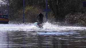Man on jet-ski makes the most of flooding on submerged Yorkshire roads [Video]