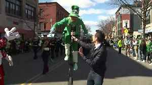 'Leprechaun' rides unicycle in St. Patrick's Day parade [Video]