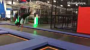 Girl does cartwheel flip inside of trampoline center and lands on head [Video]