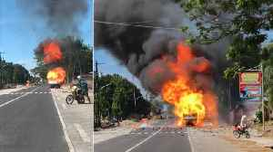Driver Reverses After Truck Catches Fire [Video]