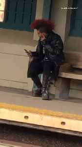 Guy with boots with mohawk waiting for train at train station [Video]