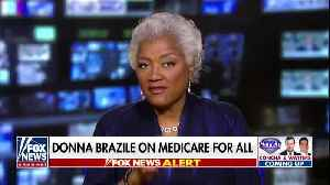 Donna Brazile and Sean Hannity spar over Medicare for All [Video]