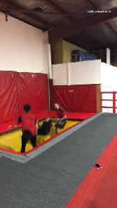 Woman bounces off of trampoline with two friends and face plants into the floor [Video]