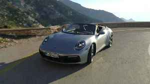 Porsche 911 Carrera S Cabriolet GT in Silver Metallic Driving Video [Video]