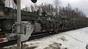 Train Transports Tons of Military Vehicles [Video]