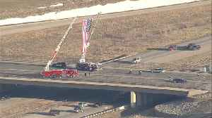 Raising a flag on the highway for Cpl. [Video]