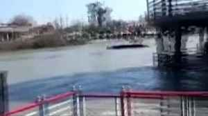 At least 40 killed as overloaded ferry sinks in Iraq's Tigris river [Video]