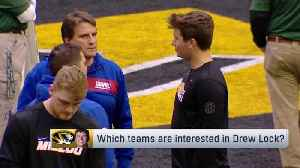 New York Giants offensive coordinator Mike Shula chats with quarterback Drew Lock before pro day workout [Video]