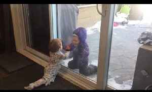 Little Girl Tries to Kiss Baby Brother Through Glass Door [Video]