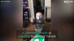 Baby tries to clap hands but slaps face instead [Video]