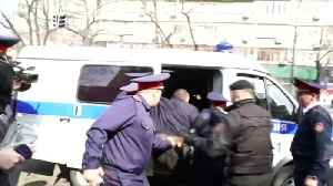 Kazakh police detain dozens at opposition rallies after president quits [Video]