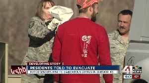 KC area firefighters standing by to perform water rescues from floodwaters [Video]