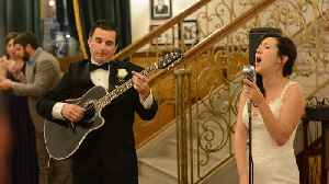 Bride And Groom Surprise Guests With Acoustic Performance [Video]