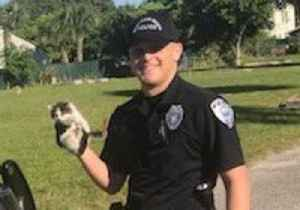 Florida Police Rescue Kitten From Patrol Car Engine [Video]