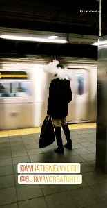 Woman wears a large feather hat at subway station [Video]