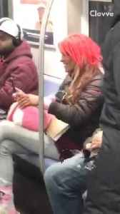 Woman in neon pink wig, pink socks, and brown crocs talks to herself on subway train [Video]