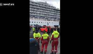 Onlookers cheer as Viking Sky cruise ship is towed into Norwegian port of Molde [Video]
