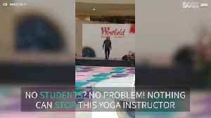 Yoga instructor teaches class of...empty mats [Video]
