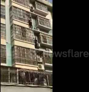 Heroic men climb four floors on building exterior to rescue child hanging from window [Video]