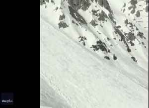 Avalanche Narrowly Misses Skiers in Austria [Video]