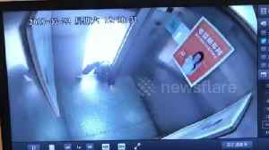 Old Chinese woman narrowly escapes death climbing out of malfunctioning elevator [Video]