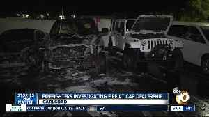 Several cars torched in fire at dealership [Video]