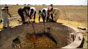 Team of villagers fish crocodile out from 30-foot drywell in west India [Video]
